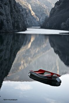 Boat on the lake ( Winter on Lake Matka Skopje Macedonia )