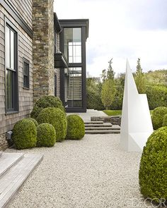 | EXTERIOR | Southampton Beach House by architect Timothy Haynes and Kevin Roberts. Cedar shingles, Boxwood shrubs and a 1991 sculpture by Sol LeWitt at the entry. Photography: Simon Upton.