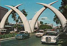 Mombasa postcard c. 1970 Peugeot Fiat and Mercedes cars with elephant tusks Mombasa Kenya, Nairobi, East Africa, Travel Goals, Homeland, Historical Photos, Tanzania, Beautiful Beaches, One Pic