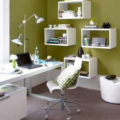 Create a modern home office by hanging large high-impact shadowboxes instead of using traditional shelves.