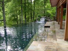 Appears to be an infinity edge pool with a rock waterfall - very nice