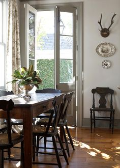 Dining area - gray trim, white walls & warm antique wood (via Nine & Sixteen) Dining Room Inspiration, Interior Inspiration, Kitchen Doors, Kitchen Dining, Homey Kitchen, Dining Area, Dining Rooms, White Walls, French Doors