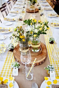 I like the patterned fabric underneath of the burlap and the tree trunks are a cool touch with the mason jars.