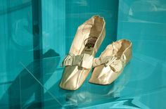 "Slippers, Chapelle, Paris: 1830's - 1840's, silk. ""Known sometimes as ""sandal slippers,"" these thinly-soled shoes were intended solely for indoor use. Even for such delicate wear, they proved decidedly fragile. While relatively inexpensive to produce and therefore to purchase, the shoes were especially popular with middle- and upper-class women who could afford to acquire and then dispose of several pairs."""