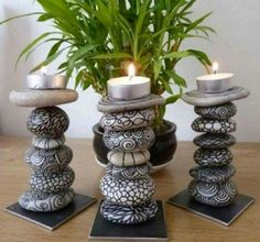 Candle holder painted rocks.