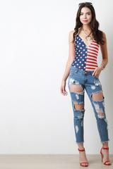 Pair this suit with jeans and heels and you're party ready!   This patriotic bodysuit features a knit fabrication, half stars and half stripes print, deep v neckline. spaghetti straps and a double snap closure at crotch.