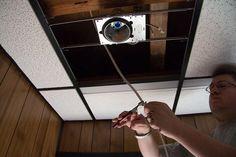 Installing recessed lighting housing Plastic Ceiling Panels, Drop Ceiling Panels, Drop Ceiling Basement, Drop Ceiling Lighting, Dropped Ceiling, Ceiling Lights, Installing Recessed Lighting, Recessed Lighting Fixtures, Concrete Ceiling