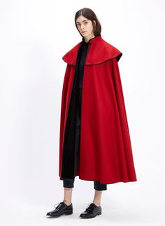 Red merino wool classic cape. Topstiched mao style collar with velvet black lining. The embozo (front facing) in contrast black velvet and black soutache clasp