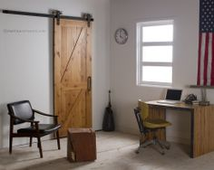 The T-Strap Barn Door Hardware goes well with the design of this office.  http://rusticahardware.com/t-strap-barn-door-hardware/