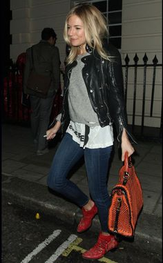 Sienna Miller. Jeans. Leather jacket. Grey jumper. Printed tee. Colourful shoes and bag.