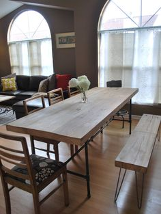 Solid reclaimed old growth wood modern dining table with our own hand welded steel  leg base. Made from 100-150 year old salvaged, reclaimed & sustainable solid wood planks from deconstructed barns, factories and buildings in the Midwest.