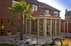 Truly bespoke, this orangery with ornate pillars was designed according to the customer's exact specification