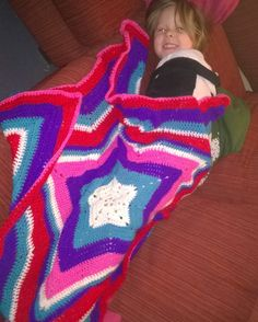 Raine loves her #crochetstarblanket I made her she takes it to bed and brings it down in the morning to snuggle on the sofa with  She looks so cute into  God I love this girl and I live making her #crochet bits  #crochetBlanket #lovetochrochet #hobby #handmade #crochetingisfun #idolovetocrochet by frogslave