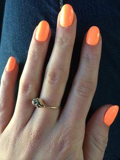 Bright orange round acrylic nails
