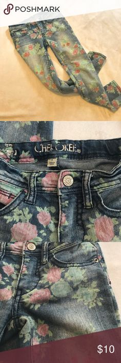 Girls skinnies Girls Skinny flowered jeans. Size 7. Great condition. Made to look kind of worn a bit in the front. My daughter hated to outgrow these!! One of her favorite pairs. Smoke free home Cherokee Bottoms Jeans