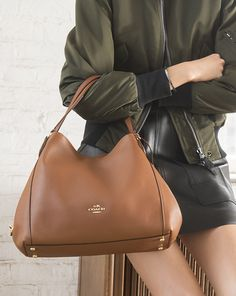 This brown leather shoulder bag is soft, slouchy, and big enough to carry all your essentials… meet the new Edie 31.