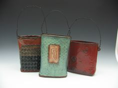 Patricia Sadler Trainor's little buckets-stamped with wire handles...