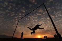 Afghan kids playing soccer. Sunset
