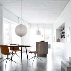Noguchi Ceiling Lamp 55A is around Akari pendant light with a small ribbed pattern on the shade. It was designed by Isamu Noguchi. Akari Noguchi 55A Pendant - In stock now.