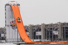Life size hot-wheel on life size track makes world record jump.