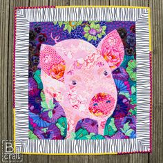 This is such a cute little piggy by Karolina Bąkowska of B-craft.pl She used various fabrics and fusible web to create the image of the pig, and then did all of her stitching with Aurifil 50wt thread!  To see more, please visit: https://b-craft.pl/urocza-swinka-z-tkanin-kaffe-fassett-collective/