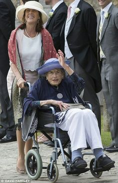 Countess Mountbatten, the daughter of Lord Mountbatten, is helped into the service in a wheelchair