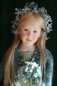 a repin of a doll by artist Jeanne Gross