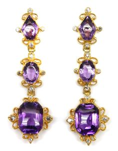 Pair of 19th century amethyst, diamond and gold pendant earrings, 1850,   each with a lozenge shaped amethyst to top, an oval cut to middle and larger cut-corner rectangular stone below, in cut-down collet gold mounts with scroll detail and a diamond to each cardinal point