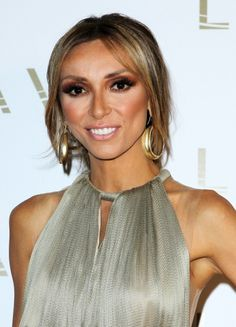 Giuliana Rancics low and twisted ponytail