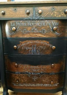 I could sponge paint edges of the drawers black and use light stenciling on the dark brown dresser and get this similar look