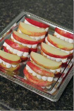 Halloween mouth snack. Apple slices, dunked in lemon juice/ water for color stay.  Marshmallow teeth with a spread of peanut butter to hold it all together!! SO cute!