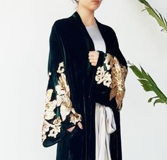 Emerald Green silk velvet abaya with intricate gold sequin detailing on the sleeves for a evening look. Available online www. Abaya Style, Hijab Style, Abaya Fashion, Kimono Fashion, Modest Fashion, Fashion Outfits, Kimono Outfit, Eid Dresses, Pakistani Dresses