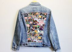 Vintage denim jacket featuring a Star Wars print and a stud adorned collar. Size: M/L Care Instructions: Hand wash, hang to dry *Please Note: No returns accepted on outerwear* Item shows typical signs