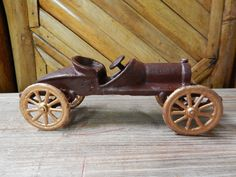 """This is a cast iron Race Car. Hubley Style. Arcade toy. Wheels are movable. Removable driver. Hand-Painted. Measurements: 7 1/2"""" Length 2 3/4"""" Tall 2 1/4"""" Wide"""