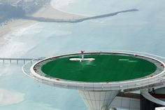 December 12, 2011. Jumeirah's Global Brand Ambassador Rory McIlroy of Northern Ireland, completes a remarkable year with another amazing bunker shot on the helipad at the Burj Al Arab hotel in Dubai, United Arab Emirates.
