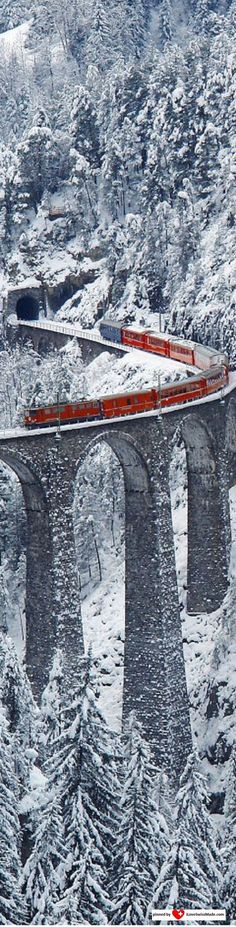 ✔ Landwasser Viaduct, Graubünden, Switzerland. The Bernina Express is a brightly colored scarlet train that crosses the Alps beginning in the town of Chur and ends in Tirano, just across the border in northern Italy. #PANDORATexas