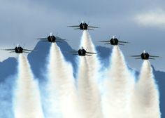 The U.S. Navy Flight demonstration team, the Blue Angels, perform their delta formation during the Blues on the Bay Air Show at Marine Corps Base Hawaii on Oct. 14, 2007. Michael Hight/U.S. Navy