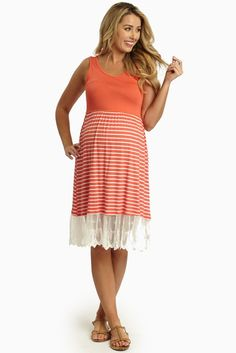 A striped bottom maternity dress with a feminine, delicate lace trim detail to bring you into the warmer days in comfortable style.