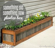 Build a planter box with old weathered wood from pallets with some new wood for a two-toned look