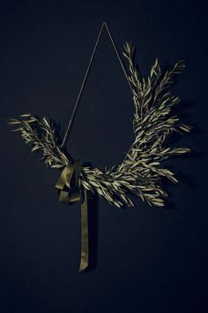 holiday wreath ideas branch wreath on black wall