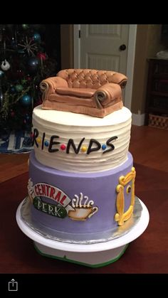 Friends cake.  Both tiers are a zebra marble cake with whipping cream/vanilla pudding filling between layers. Covered in buttercream icing. Fondant embellishments and a Rice Krispie couch.