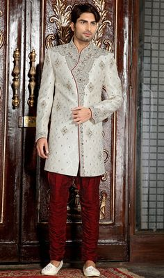 Stun bystanders simply by enchaining charm in this off white brocade embroidered men's sherwani. Beautified with gold zardosi, lace, moti, patch, resham and stones work. Brocade might vary from actual image. #Men'sShervani