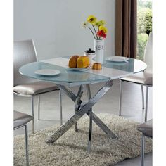 This modern glass top table is stylish, yet simple. It sets the mood of the incredible atmosphere of sophisticated fashionable style.        .
