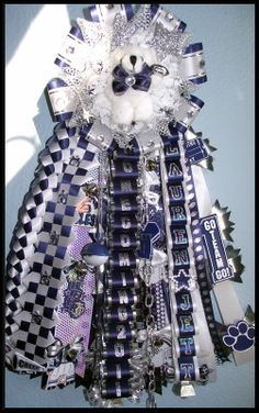 Single Homecoming Garter Idea.  Garter!  In High School!  I think NOT>> and it is gaudy as hell