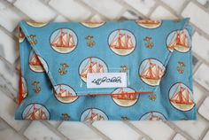 Sailboat & anchor nautical Crayon Clutch on Etsy.  $18.  Great for gifts!