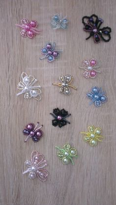 beaded butterflies. these would look so pretty on a sun catcher or wind chime.