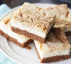 These cinnamon roll cheesecake bars are Amazing, just imagine a sweet and salty, cinnamony graham cracker crust, then...