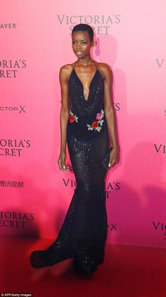 Coming up roses: Tanzanian model Herieth Paul was elegant in a glittering gown