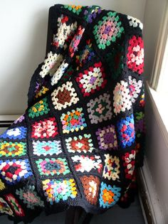 Crochet Granny Square Blanket - the granny square afghan that we had from Grandma Nageotte was with a black border.  Unfortunately, it burnt in the fire.