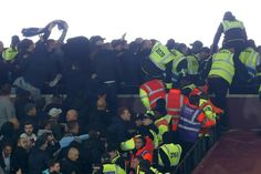 West Ham violence could damage safe standing campaign: Wenger   London (AFP)  Arsenal manager Arsene Wenger fears the crowd trouble that marred West Ham Uniteds League Cup victory over Chelsea and left 200 fans facing banning orders could damage the campaign for safe standing areas in stadiums.  Rival fans threw coins seats and bottles inside West Hams London Stadium on Wednesday and were involved in clashes in the streets around the east London ground.  Seven arrests were made and West Ham…